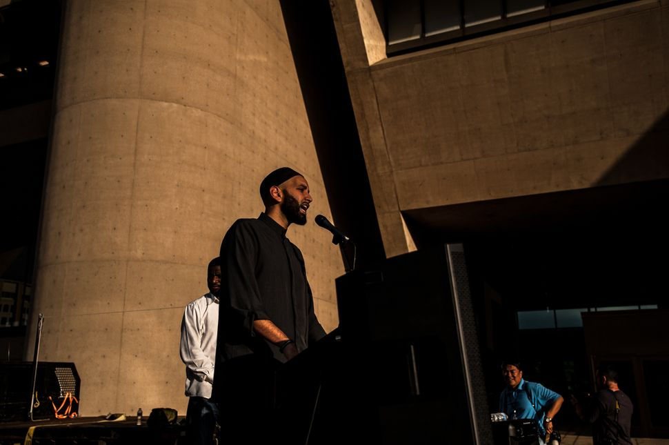 A speaker addressesattendees at the Dallas Stands Against the NRA rally onFriday.