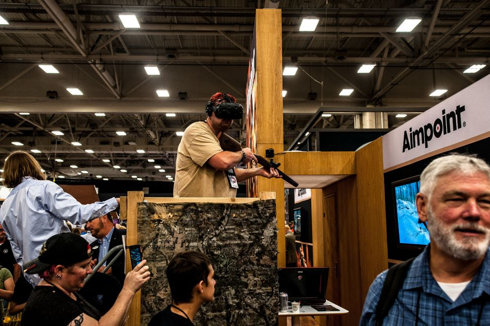 A man takes part in a virtual reality simulation on the expo floor Saturday.