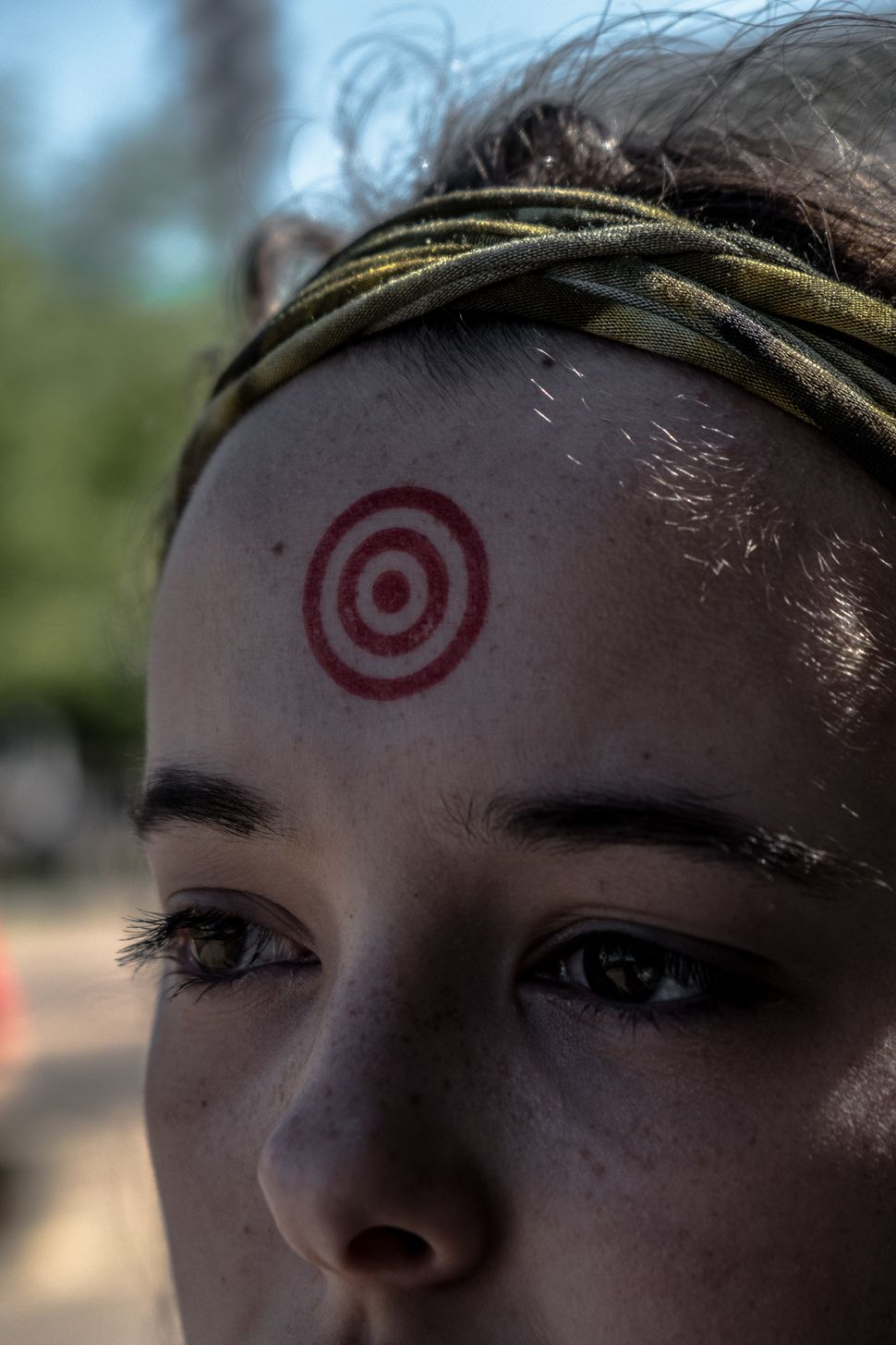 Julia Heilrayne, a student at Austin High School, stands with a target painted on her head ata gun control rallyo
