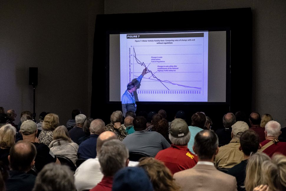 "Economist and author John Lott Jr. addresses attendees of ""The War on Guns"" seminar at the NRA annual meeting on May 6."