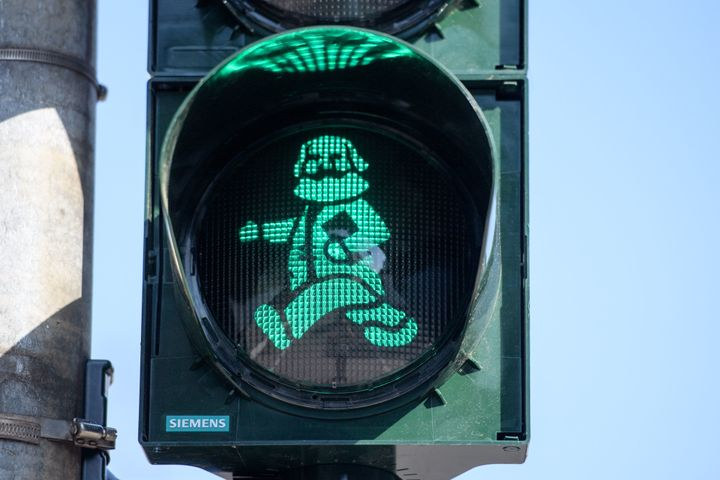 A pedestrian traffic light in Trier, Germany, with a depiction of Marx, pictured on the 200th anniversary of his birth,