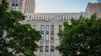 Chicago Tribune signage is displayed on the side of the Tribune Tower in Chicago, Illinois, U.S., on Friday, Aug. 7, 2015. Tribune Media Co. is scheduled to report second-quarter earnings results before the opening of U.S. financial markets on August 13. Photographer: Christopher Dilts/Bloomberg via Getty Images