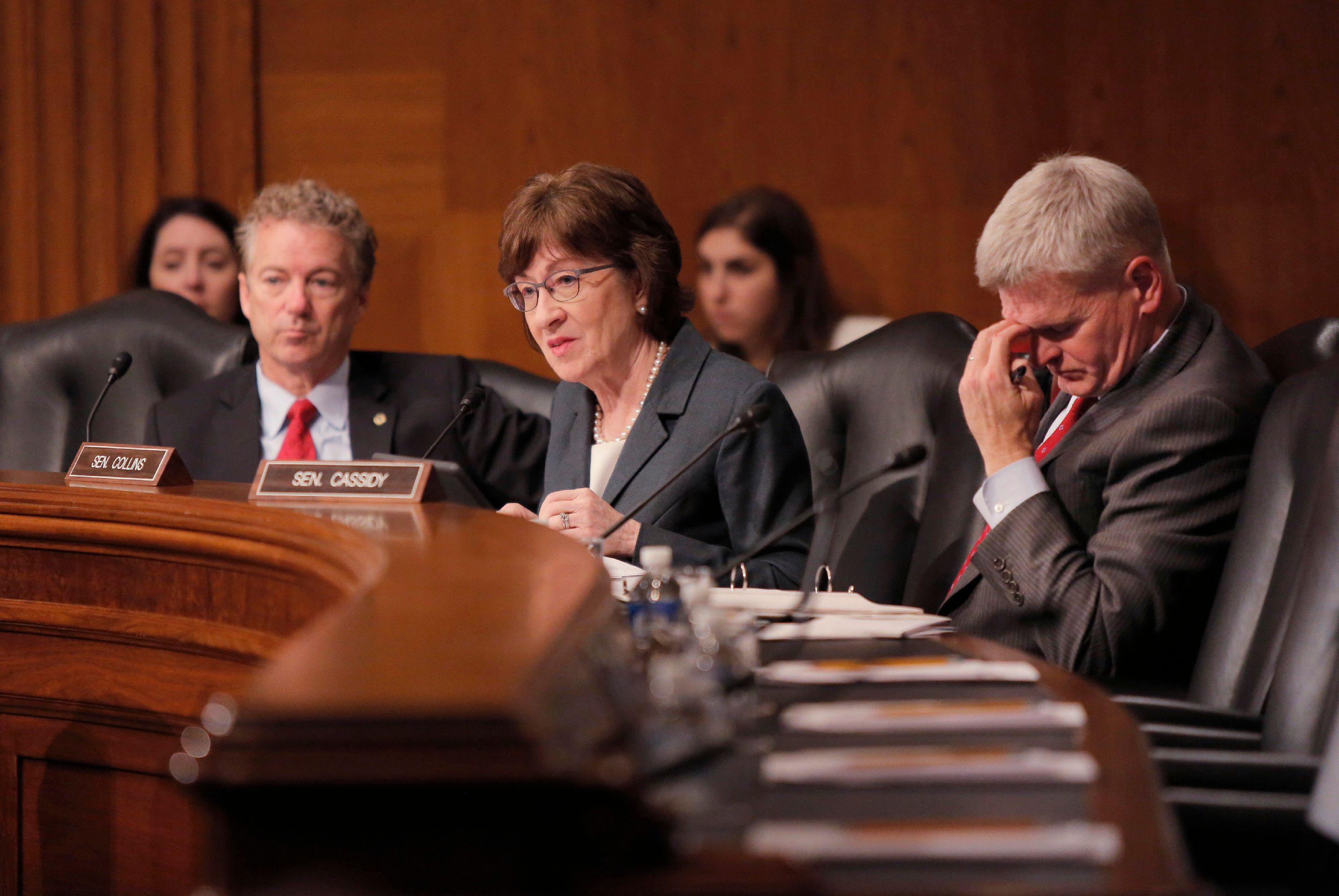 WASHINGTON, D.C. - DECEMBER 12: Flanked by Sen. Rand Paul (R-KY), left and Sen. Bill Cassidy (R-LA), Sen. Susan Collins asks questions of a panel during a hearing of the Health, Education, Labor and Pensions Committee on Capitol Hill in Washington, D.C. on Tuesday, December 12, 2017. (Staff Photo by Gregory Rec/Portland Press Herald via Getty Images)