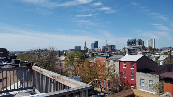 The view of downtown Baltimore from the roof of Jeannette Belliveau's historic townhouse, which she rents to short-term guest