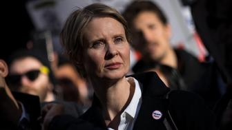 NEW YORK, NY - MAY 1: New York gubernatorial candidate Cynthia Nixon stands with activists as they rally against financial institutions' support of private prisons and immigrant detention centers, as part of a May Day protest near Wall Street in Lower Manhattan, May 1, 2018 in New York City. Across the world, people are protesting and marching on the traditional day of workersÕ rights. (Photo by Drew Angerer/Getty Images)