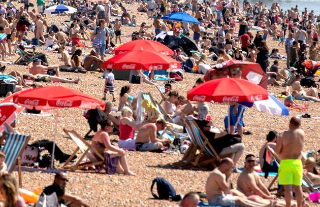 People enjoying the hot weather on Brighton beach.