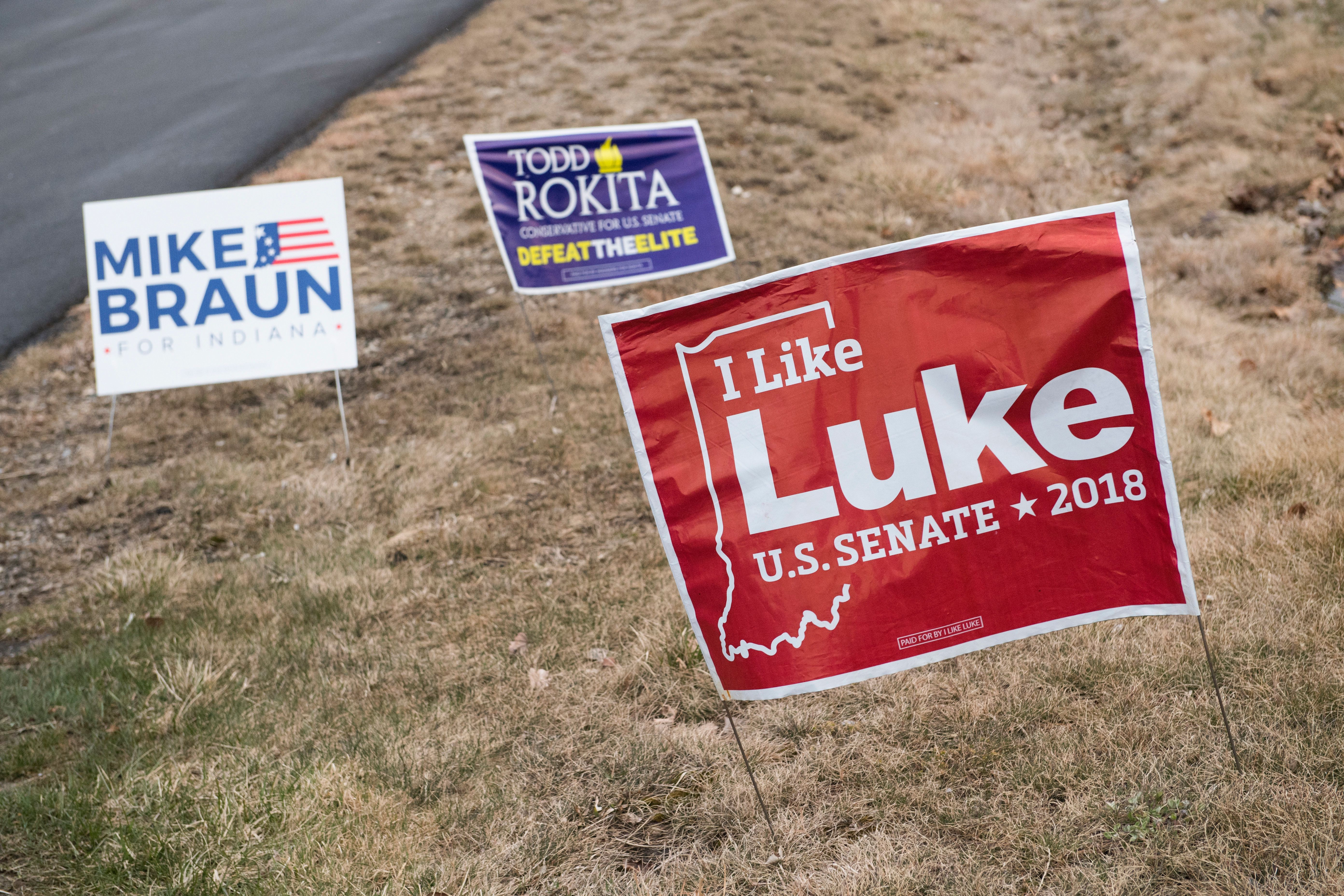 UNITED STATES - APRIL 4: Signs for Mike Braun, Reps. Todd Rokita, R-Ind., and Luke Messer, R-Ind., who are running for the Republican nomination for Senate in Indiana, are seen outside the Steuben County Lincoln Day Dinner in Angola, Ind., on April 4, 2018. (Photo By Tom Williams/CQ Roll Call)