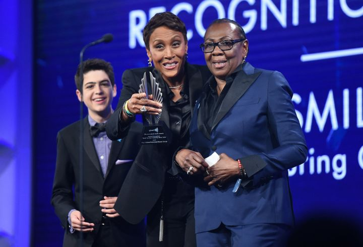 Joshua Rush (left) and Robin Roberts present Gloria Carter with a special recognition award at the 2018 GLAAD Media Awards in