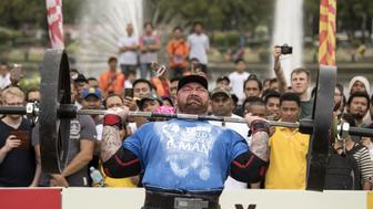 Hafthor Julius Bjornsson of Iceland lifts weights during the Max Overhead competition of the 2018 Worlds Strongest Man in Manila on May 5, 2018. (Photo by NOEL CELIS / AFP) / RESTRICTED TO EDITORIAL USE        (Photo credit should read NOEL CELIS/AFP/Getty Images)