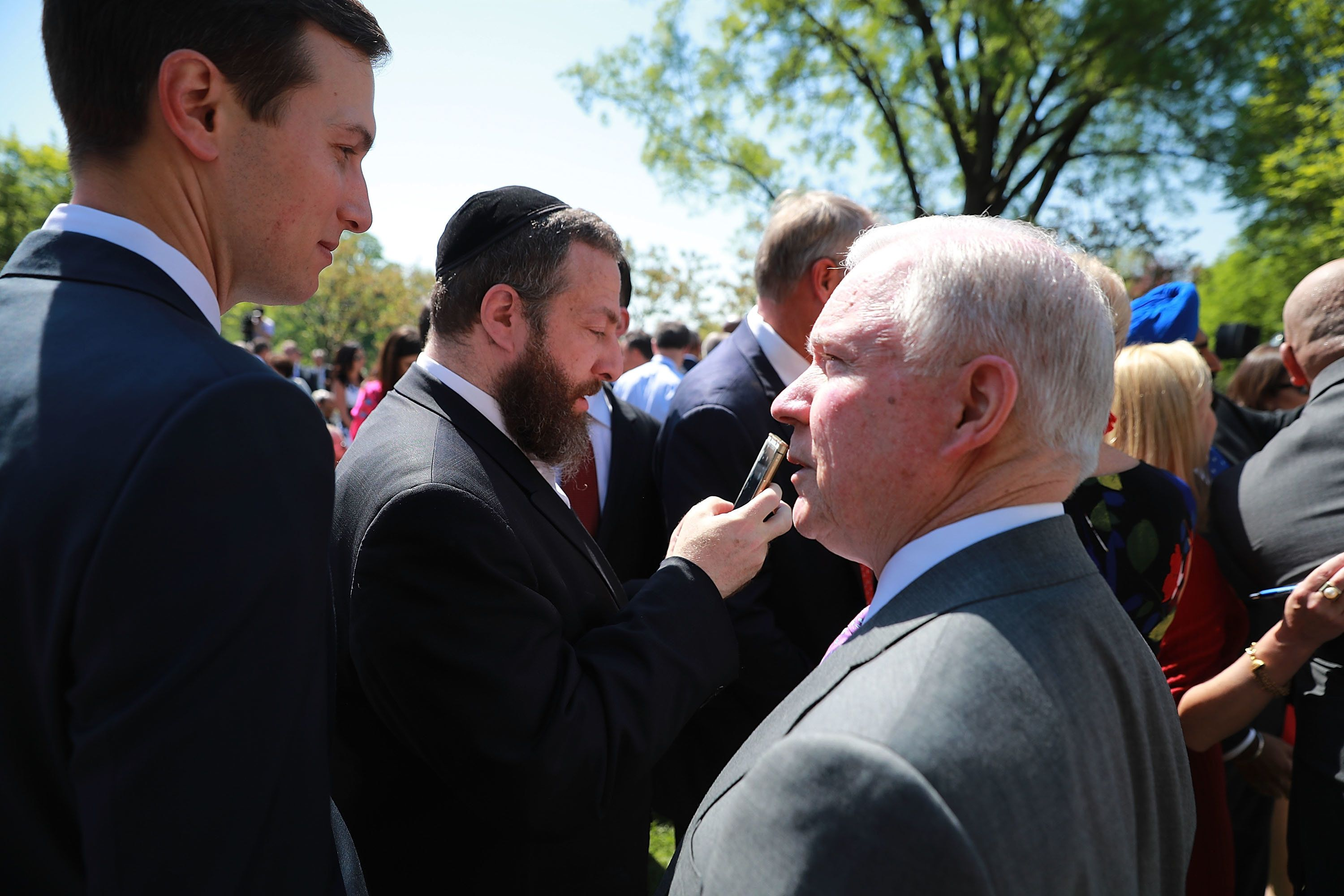 WASHINGTON, DC - MAY 03:  U.S. Attorney General Jeff Sessions (R) and Senior Advisor to the President and Donald Trump's son-in-law Jared Kushner (L) talk before an event to mark the National Day of Prayer in the Rose Garden at the White House May 3, 2018 in Washington, DC. The White House invited leaders from various faiths and religions to participate in the day of prayer, which was designated in 1952 by the United States Congress to ask people 'to turn to God in prayer and meditation.'  (Photo by Chip Somodevilla/Getty Images)
