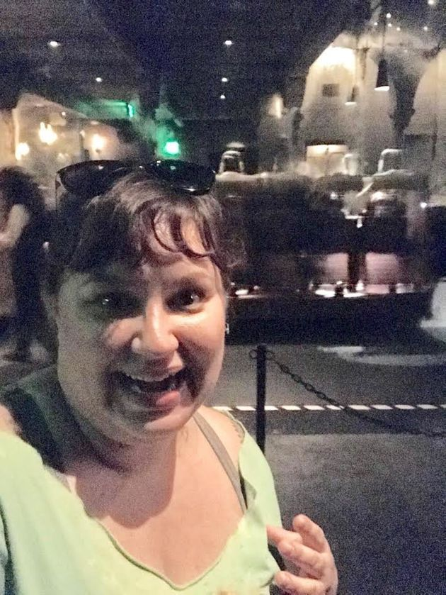 Jana Schmieding stands in front of the Harry Potter and the Forbidden Journey ride at Universal Studios...