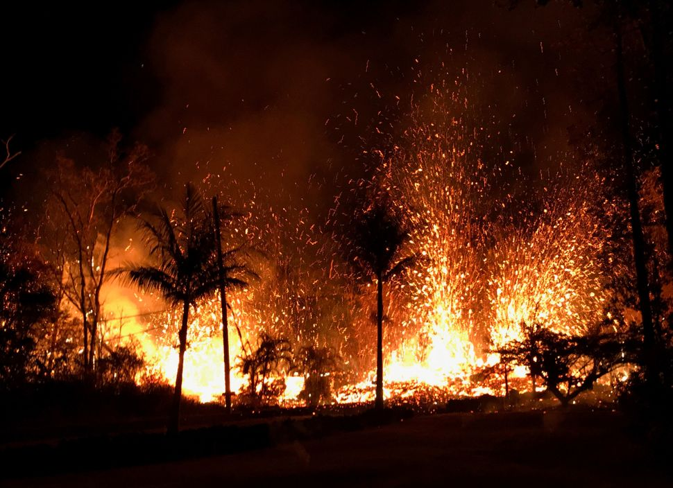 Lava erupts from a fissure in Leilani Estates on Saturday.