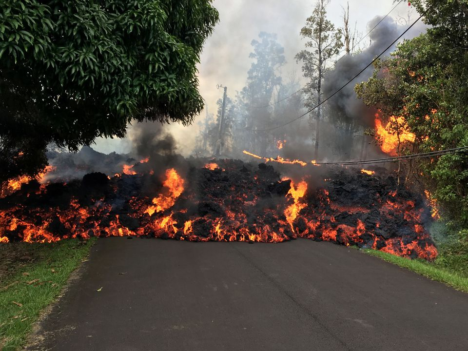 A lava flow moves on Makamae Street on Sunday in Leilani Estates.