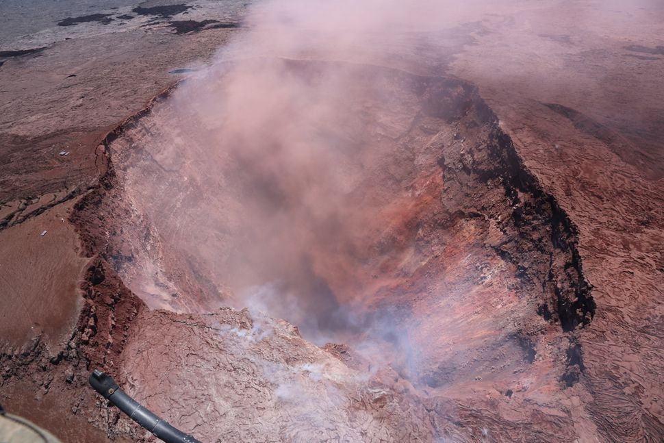 The collapsed Puu Oo crater, which formed on April 30, spews ash on Hawaii's Kilauea volcano on Thursday.