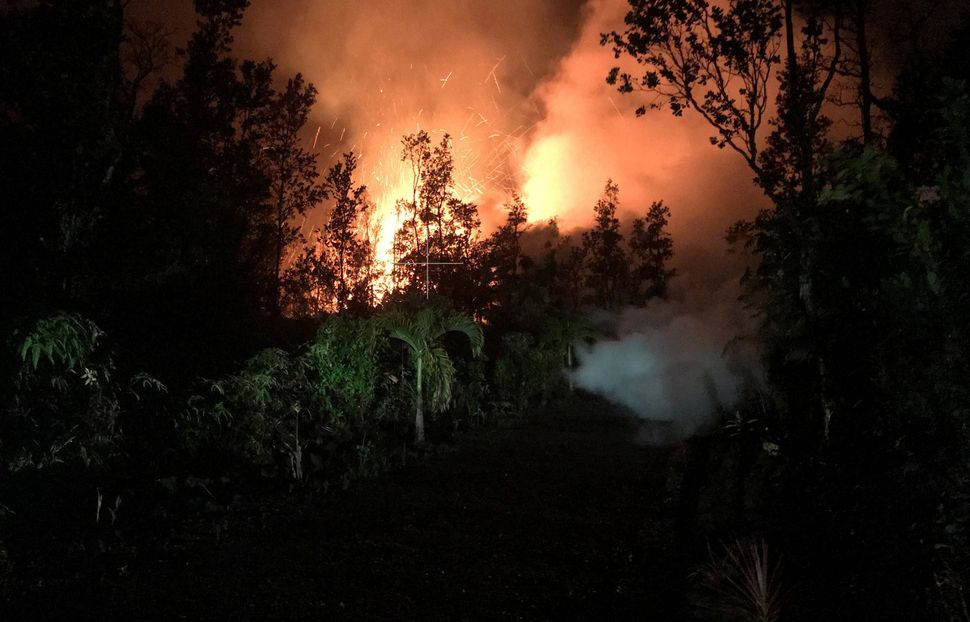 A fissure in Leilani Estates lights up its surroundings on Friday.