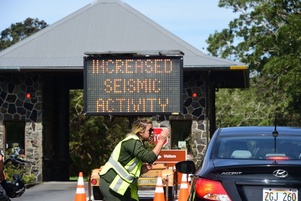 Personnel at Hawaii Volcanoes National Park turn people away on Saturday.