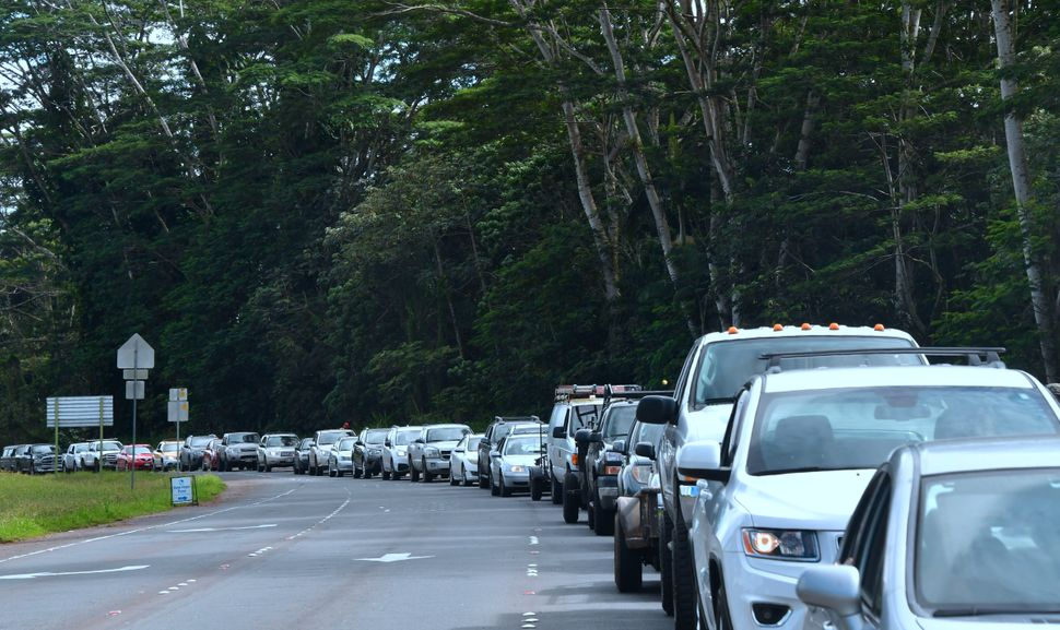 Vehicles head for the intersection of Pahoa and Kapoho roads as evacuees are allowed to return to their Leilani Estates homes
