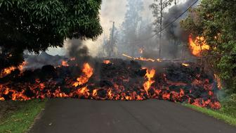 PAHOA, HI - MAY 6: In this handout photo provided by the U.S. Geological Survey, a lava flow moves on Makamae Street after the eruption of Hawaii's Kilauea volcano on May 6, 2018 in the Leilani Estates subdivision near Pahoa, Hawaii. The governor of Hawaii has declared a local state of emergency near the Mount Kilauea volcano after it erupted following a 5.0-magnitude earthquake, forcing the evacuation of nearly 1,700 residents. (Photo by U.S. Geological Survey via Getty Images)