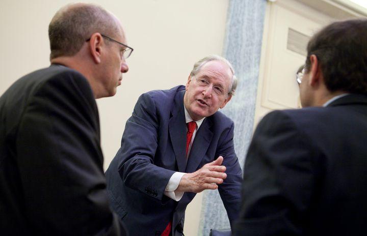 Then-Sen. Jay Rockefeller (center) talks to FTC chairman Jon Leibowitz, left, and FCC chairman Julius Genachowski(right