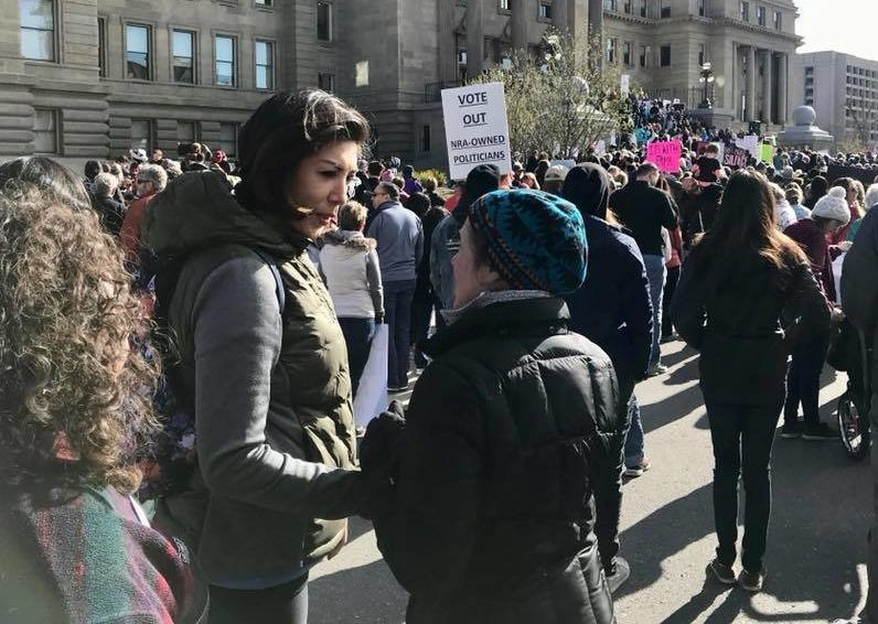 Jordanlistens to women during the Women's March outside the Idaho Capitol in March 2018.
