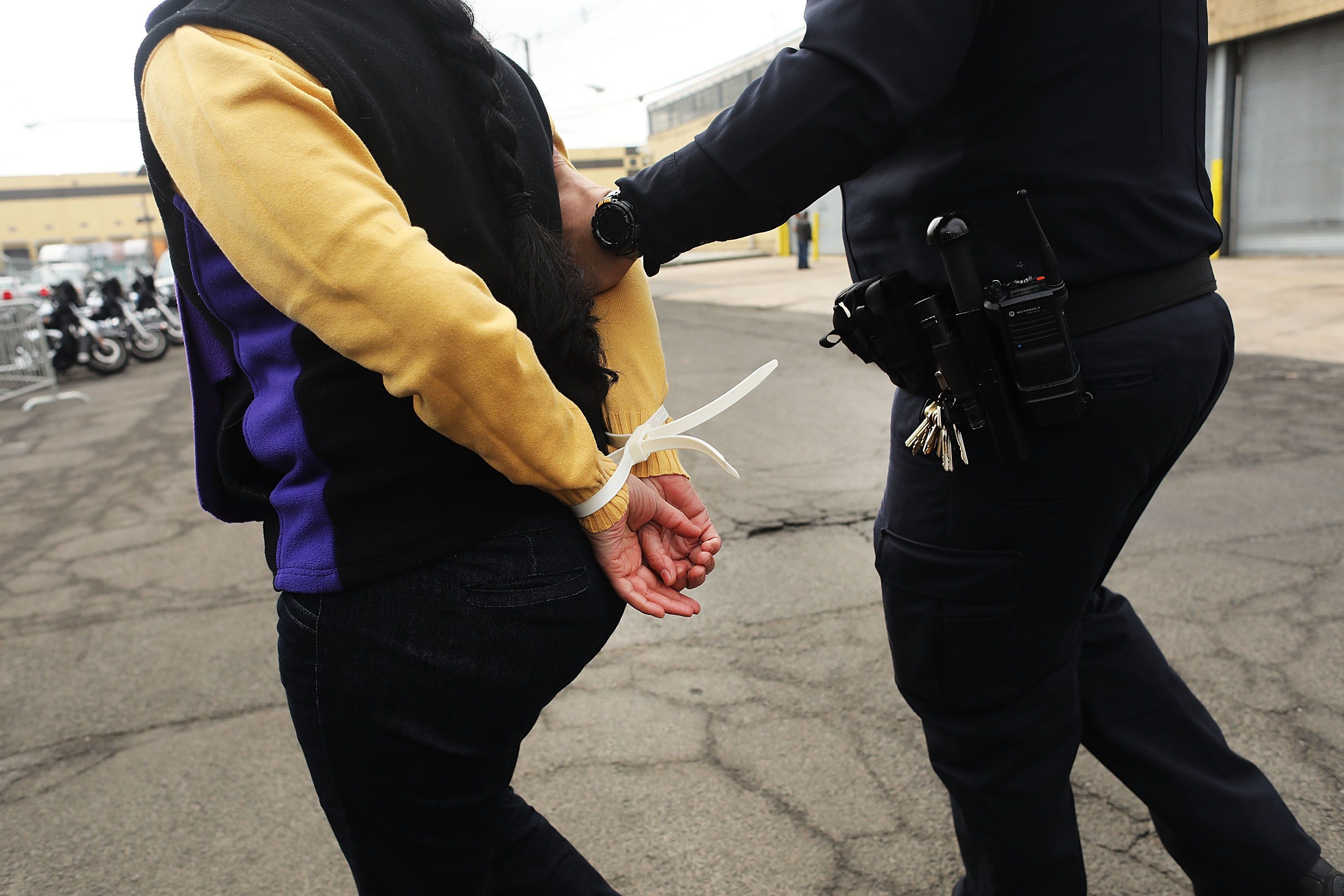 ELIZABETH, NJ - FEBRUARY 23:  Police arrest a protester outside of the Elizabeth Detention Center during a rally attended by immigrant residents and activists on February 23, 2017 in Elizabeth, New Jersey. Over 100 demonstrators chanted and held up signs outside of the center which is currently holding people awaiting deportation. The demonstrators denounced President Donald Trump and his deportation policies. Around the country stories of Immigration and Customs Enforcement (ICE) raids have sent fear through immigrant communities.  (Photo by Spencer Platt/Getty Images)