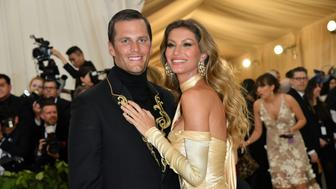 Tom Brady (L) and Gisele Bundchen arrive for the 2018 Met Gala on May 7, 2018, at the Metropolitan Museum of Art in New York. (Photo by Angela WEISS / AFP) / The erroneous mention[s] appearing in the metadata of this photo by Angela WEISS has been modified in AFP systems in the following manner: [Gisele Bundchen] instead of [Gisele Brundchen]. Please immediately remove the erroneous mention[s] from all your online services and delete it (them) from your servers. If you have been authorized by AFP to distribute it (them) to third parties, please ensure that the same actions are carried out by them. Failure to promptly comply with these instructions will entail liability on your part for any continued or post notification usage. Therefore we thank you very much for all your attention and prompt action. We are sorry for the inconvenience this notification may cause and remain at your disposal for any further information you may require.        (Photo credit should read ANGELA WEISS/AFP/Getty Images)