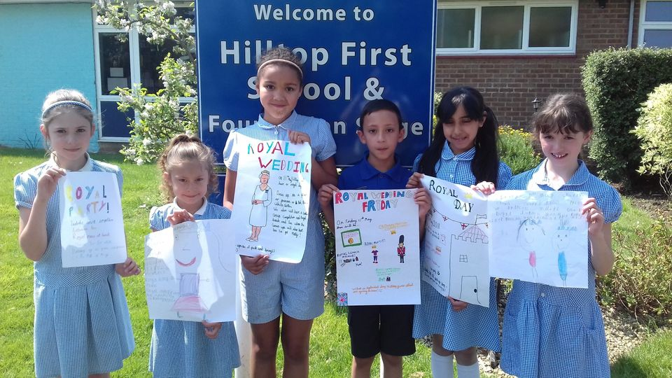 Pupils at Hilltop Primary School with their royal wedding posters.
