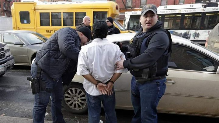 Immigration and Customs Enforcement officers make an arrest in New York.