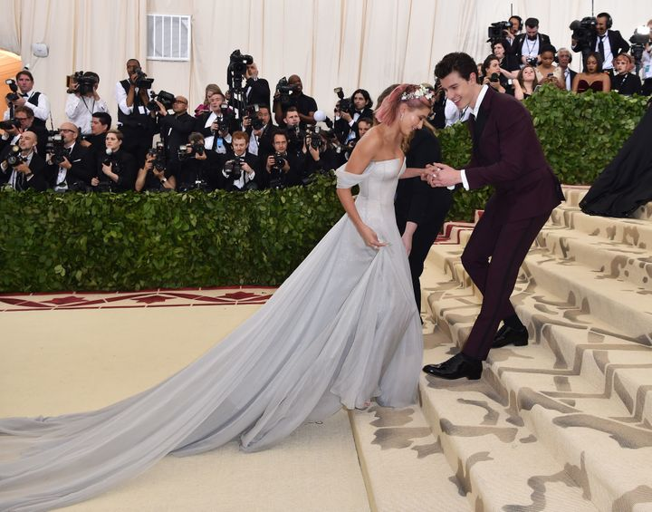 Shawn Mendes makes sure Hailey Baldwin doesn't trip on her way up the stairs at the 2018 Met Gala.