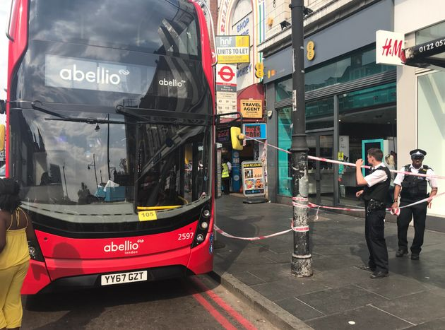 A double-decker bus has been taped off by police following a suspected acid attack in Brixton, south