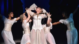 NEW YORK, NY - MAY 07:  Madonna performs during  the Heavenly Bodies: Fashion & The Catholic Imagination Costume Institute Gala at The Metropolitan Museum of Art on May 7, 2018 in New York City.  (Photo by Kevin Mazur/MG18/Getty Images for The Met Museum/Vogue)