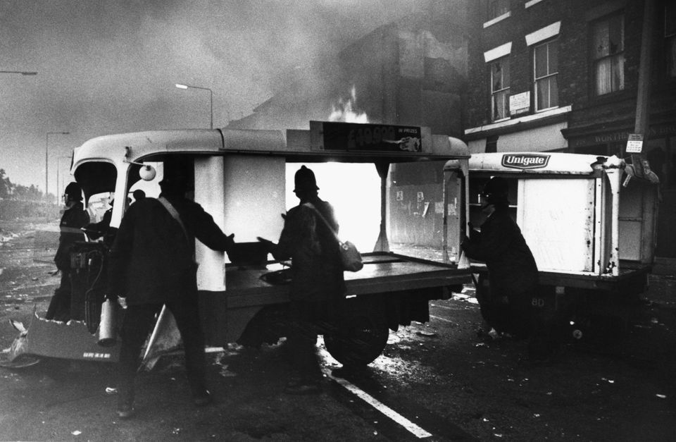Looted shops burn during the Toxteth riots in 1981.