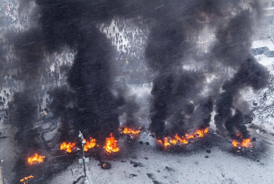 Smoke from burning tyres set ablazeduring the very cold Ukrainian Revolution in