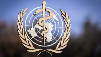 The logo of the World Health Organization (WHO) is pictured on the facade of the WHO headquarters on October 24, 2017 in Geneva. The head of the World Health Organization on October 22, 2017 reversed his decision to name Zimbabwe's President Robert Mugabe a goodwill ambassador, saying it was in the 'best interests' of the UN agency. / AFP PHOTO / Fabrice COFFRINI        (Photo credit should read FABRICE COFFRINI/AFP/Getty Images)