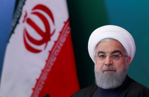 Iranian President Hassan Rouhani attends a meeting with Muslim leaders and scholars in Hyderabad, India,...