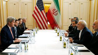 US Secretary of State John Kerry (L)  meets with Iranian Foreign Minister Javad Zarif (2R) in Vienna, Austria on January 16, 2016, on what is expected to be 'implementation day,'  the day the International Atomic Energy Agency (IAEA) verifies that Iran has met all conditions under the nuclear deal.    / AFP / POOL / KEVIN LAMARQUE        (Photo credit should read KEVIN LAMARQUE/AFP/Getty Images)