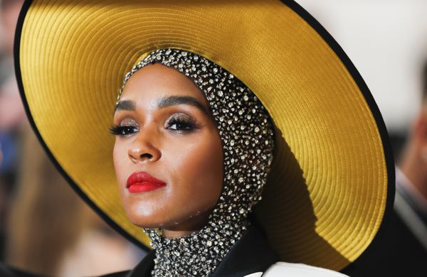 Singer Janelle Monáe walks to the Met Gala with a headpiece that framed her face with a golden halo.
