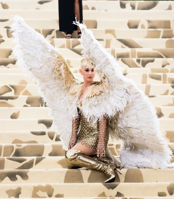 Singer-songwriter (and pastors' daughter) Katy Perry came to the gala in a chain-mail gold Versace dress and giant feathered