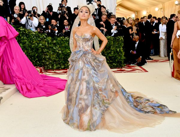 "Ariana Grande attended the Met Gala wearing a Vera Wang ball gown <a href=""https://www.nytimes.com/2018/05/07/style/met-gala."
