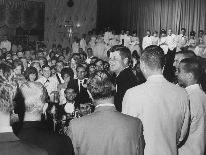 President John F. Kennedy visits students at the 1963 John Burroughs High School prom.