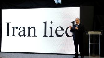 Israeli Prime minister Benjamin Netanyahu speaks during a news conference at the Ministry of Defence in Tel Aviv, Israel, April 30, 2018. REUTERS/ Amir Cohen