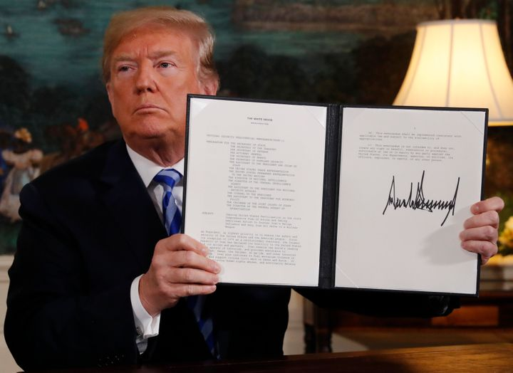 U.S. President Donald Trump displays a presidential memorandum after announcing his intention to withdraw from the JCPOA.