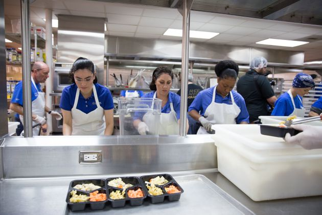 Volunteers prepare meals for delivery at Project Angel Food in Los Angeles. The photo was taken after...