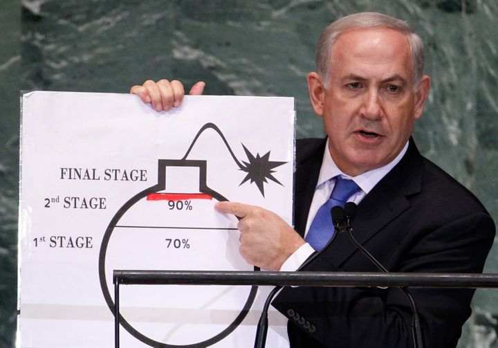 Israeli Prime Minister Benjamin Netanyahu points to a red line he drew on the graphic of a bomb used to represent Iran's nucl