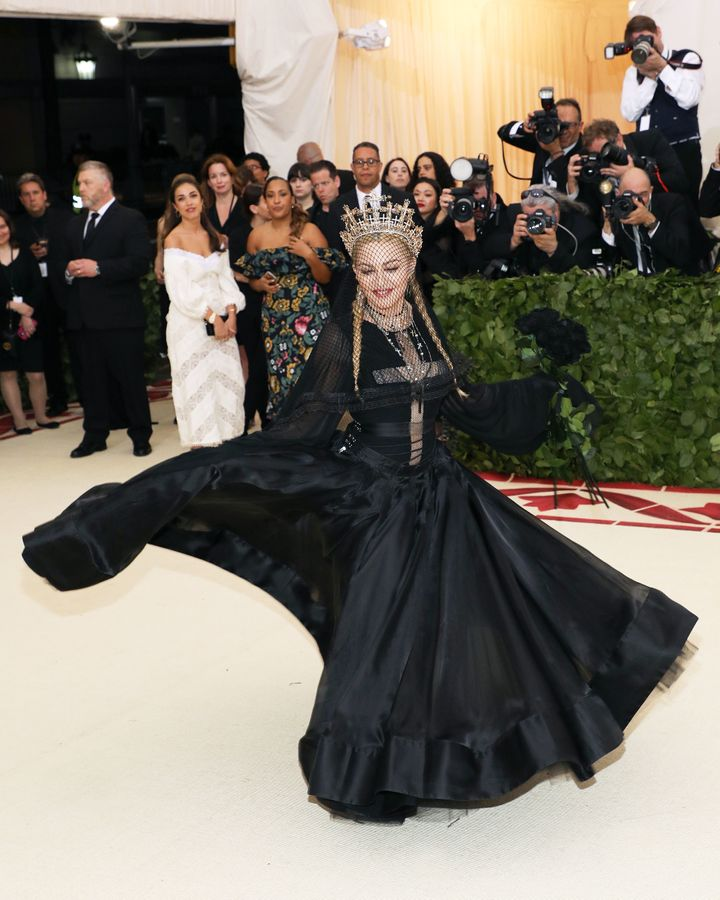 """Tonight I feel so close to God,"" Madonna, wearing a black Jean-Paul Gaultier gown, told Vogue."