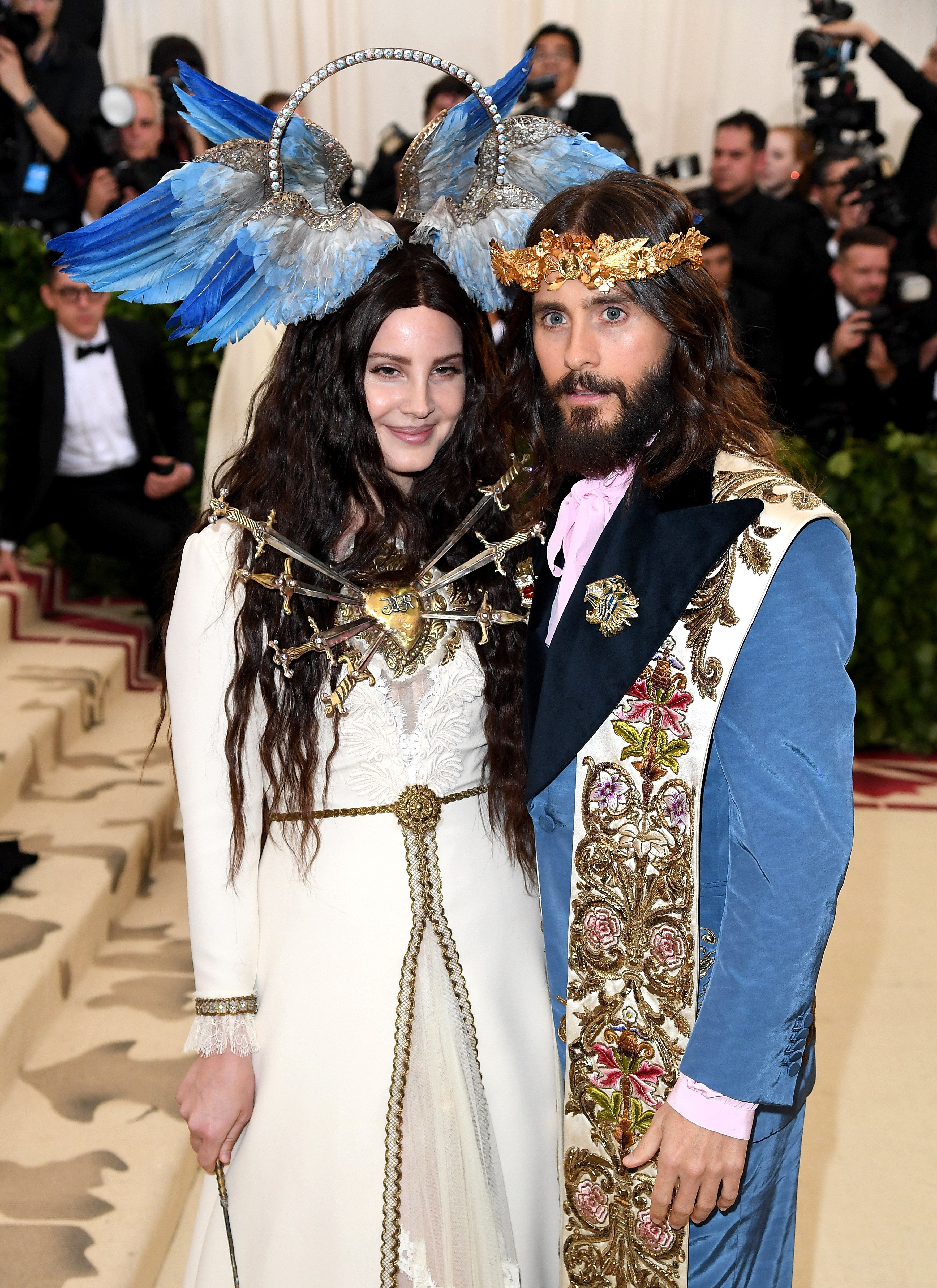 Lana Del Rey, here with Jared Leto, wore a cream-colored Gucci dress and a halo embellished with blue wings. But th