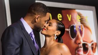 """Cast member Will Smith and his wife Jada Pinkett Smith kiss at the premiere of """"Focus"""" at the TCL Chinese theatre in Hollywood, California February 24, 2015. The movie opens in the U.S. on February 27.   REUTERS/Mario Anzuoni  (UNITED STATES - Tags: ENTERTAINMENT)"""