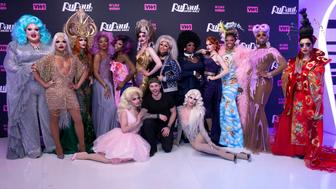 NEW YORK, NY - MARCH 21:  Gus Kenworthy (C) joins the cast of 'RuPaul's Drag Race' Season 10 for a photo. Season 10 cast are Eureka O' Hara, Vanessa Vanjie Mateo, Kameron Michaels, The Vixen, Monique Heart, Miz Cracker, Dusty Ray Bottoms, Aquaria, Kalorie Karbdashian-Williams, Mayhem Miller, Blair St. Clair  Asia O' Hara, Monet X Change and Yuhua Hamasaki at TRL Studios on March 21, 2018 in New York City.  (Photo by Santiago Felipe/Getty Images)