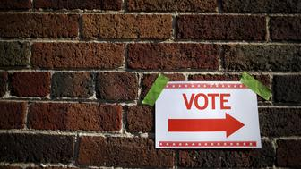 A sign is taped to a brick wall outside a polling station for the Wisconsin presidential primary election in Milwaukee, Wisconsin, United States, April 5, 2016.     REUTERS/Jim Young