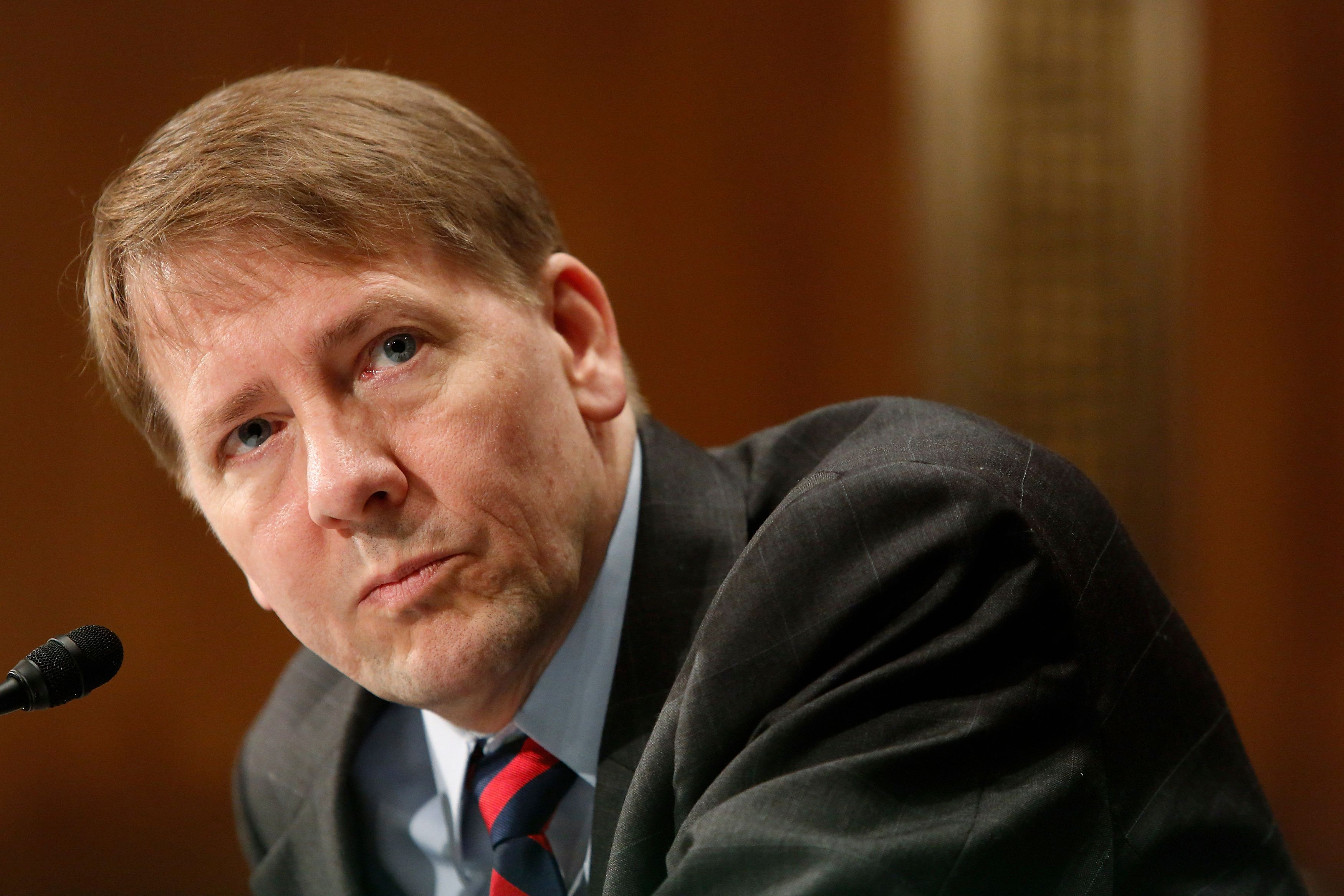 U.S. Consumer Financial Protection Bureau (CFPB) Director Richard Cordray testifies before a Senate Banking Committee hearing on Capitol Hill in Washington June 10, 2014. REUTERS/Jonathan Ernst    (UNITED STATES - Tags: POLITICS BUSINESS)